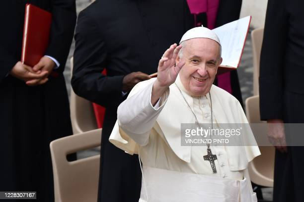 Pope Francis waves to attendees during a limited public audience at the San Damaso courtyard in The Vatican on September 2 2020 during the COVID19...