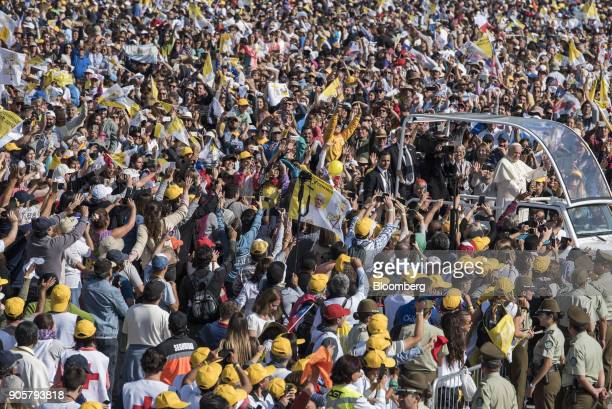 Pope Francis waves to attendees from a motorcade before mass at O'Higgins Park in Santiago Chile on Tuesday Jan 16 2018 400000 Chileans attended Pope...