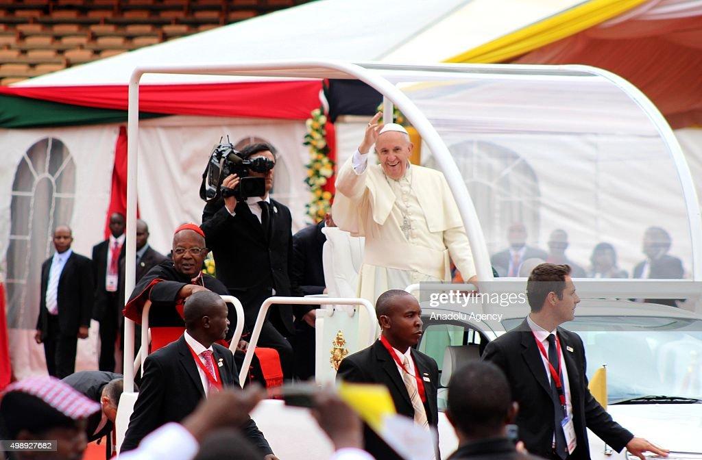 Pope Francis waves to crowd as he arrives at the Kasarani stadium in Nairobi, Kenya on November 27, 2015.