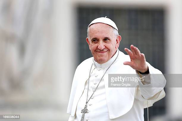 Pope Francis waves to faithful as he arrives in St Peter's Square for the celebration of Pentecost Vigil with lay Ecclesial movements on May 18 2013...