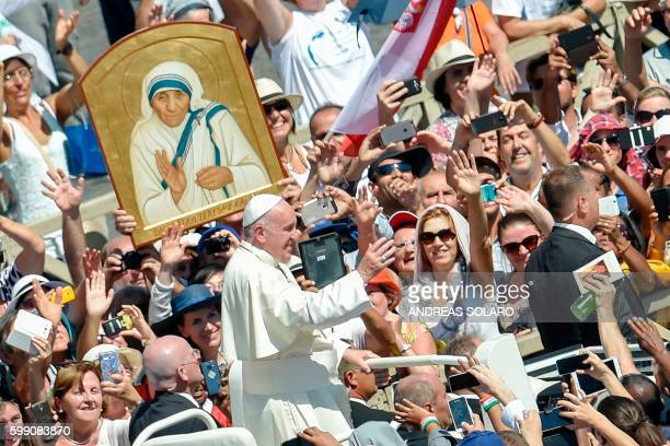 TOPSHOT Pope Francis waves to faithful as he leaves after a Holy Mass and the canonisation of Mother Teresa of Kolkata on Saint Peter square in the...