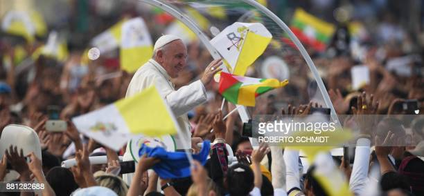TOPSHOT Pope Francis waves to Myanmar catholics prior to an open air mass in Yangon on November 29 2017 Pope Francis is to hold mass in Yangon with...