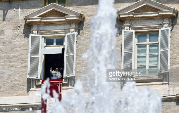 Pope Francis waves to pilgrims gathered in St Peter's square at the Vatican during his Sunday Angelus prayer on August 5 2018