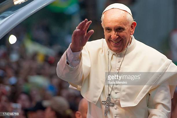 Pope Francis waves to the crowd after departing the Metropolitan Cathedral in the Popemobile after arriving in Rio on July 22 2013 in Rio de Janeiro...