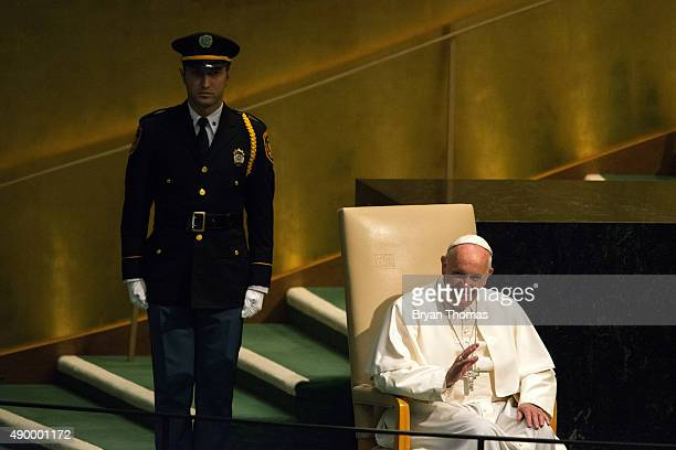 Pope Francis waves to the crowd after entering the General Assembly of the United Nations on September 25 2015 in New York City Pope Francis who...