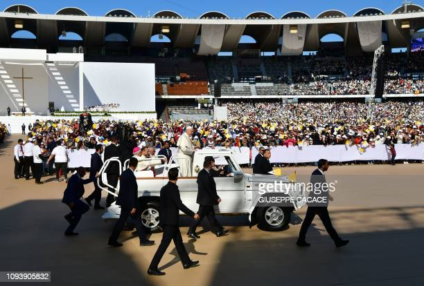 Pope Francis waves to the crowd as he arrives to lead mass for an estimated 170000 Catholics at the Zayed Sports City Stadium on February 5 2019