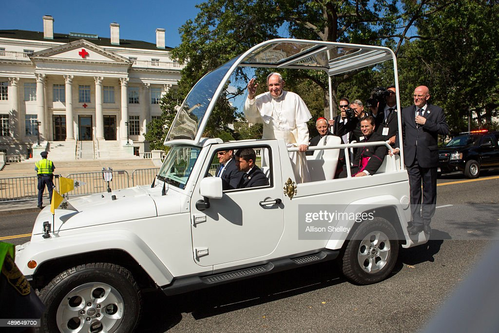 Pope Francis waves to the crowd as he rides in a popemobile along a parade route around the National Mall on September 23, 2015 in Washington, DC. Thousands of people gathered near the Ellipse to catch of glimpse of Pope Francis after he addressed an audience of 15,000 invited guests on the South Lawn of the White House during an official arrival ceremony with President Barack Obama. The Pope began his first trip to the United States at the White House followed by a visit to St. Matthew's Cathedral, and will then hold a Mass on the grounds of the Basilica of the National Shrine of the Immaculate Conception.
