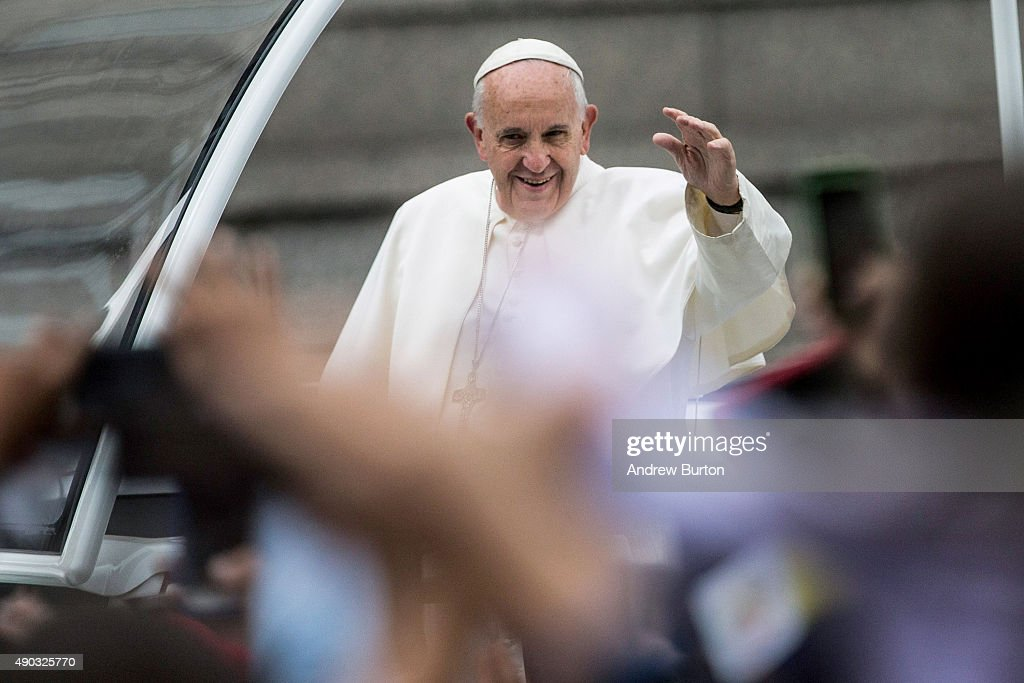 Pope Francis waves to the crowd from his popemobile while on his way to lead Mass at Benjamin Franklin Parkway on September 27, 2015 in Philadelphia, Pennsylvania. Pope Francis is on the final day of his trip to the United States and will conduct Mass and meet with organizers, volunteers and benefactors of the World Meeting of Families before returning to Rome this evening.
