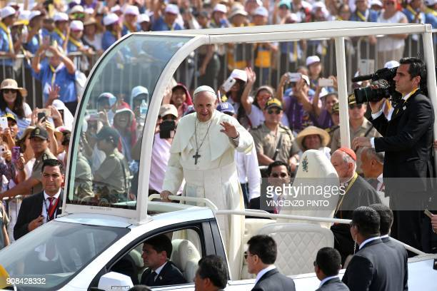 Pope Francis waves to the crowd from the popemobile at Las Palmas air base in Lima where the pontiff will celebrate mass on January 21 2018 Pope...