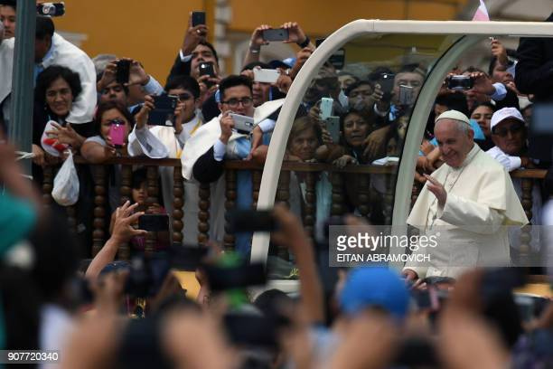 Pope Francis waves to the crowd from the popemobile at Plaza de Armas square in the Peruvian city of Trujillo on January 20 2018 Pope Francis headed...