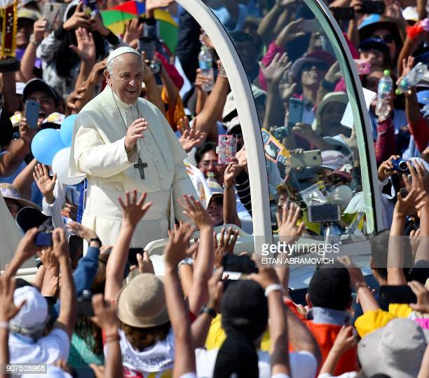 Pope Francis waves to the crowd from the popemobile at the beach resort town of Huanchaco northwest of the Peruvian city of Trujillo where he will...