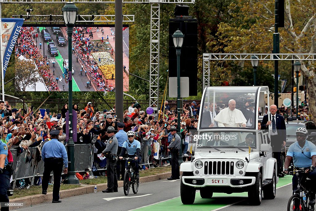 Pope Francis waves to the crowd from the Popemobile during a parade September 27, 2015 in Philadelphia, Pennsylvania. Pope Francis is in Philadelphia for the last leg of his six-day visit to the U.S.