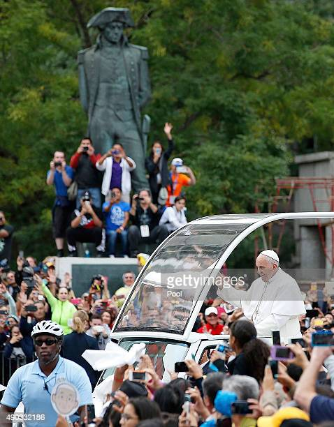 Pope Francis waves to the crowd from the Popemobile during a parade September 27 2015 in Philadelphia Pennsylvania Pope Francis is in Philadelphia...