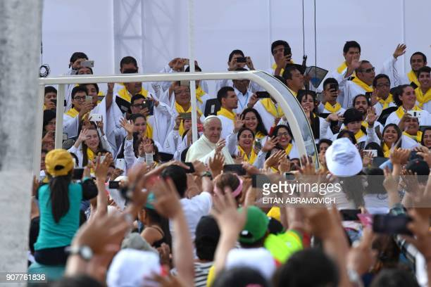 Pope Francis waves to the crowd from the popemobile in the streets of the Peruvian city of Trujillo on January 20 2018 Pope Francis condemned...