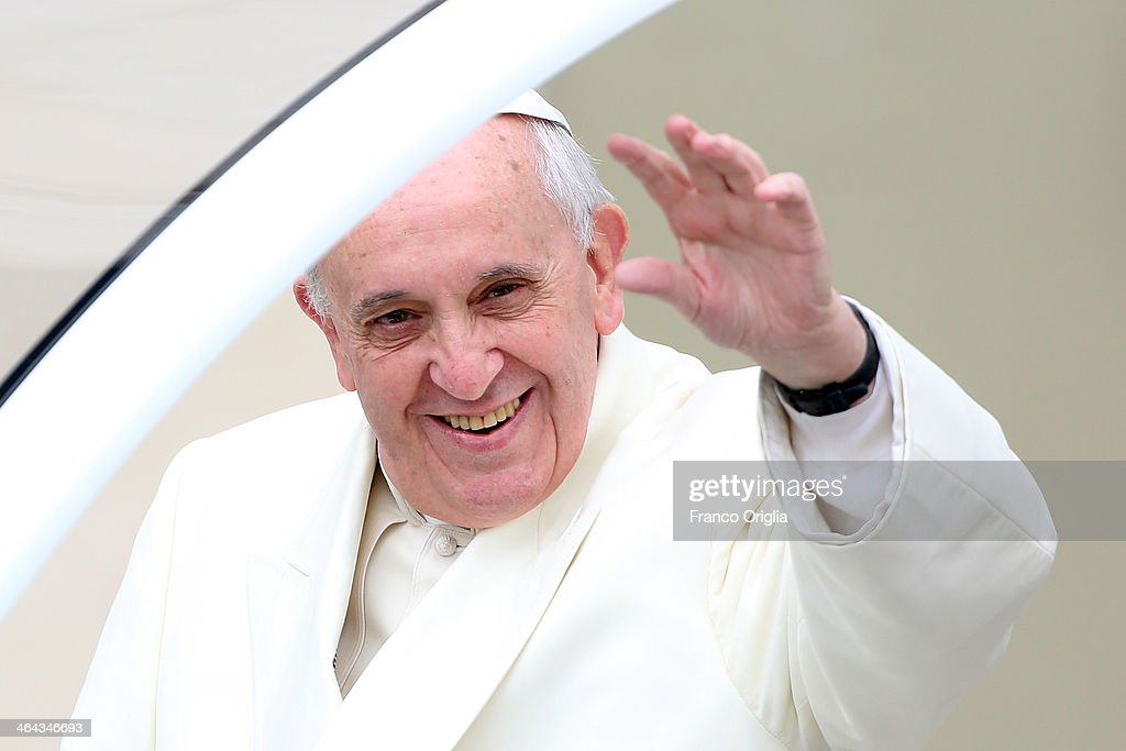 Pope Francis waves to the crowds as he arrives in St. Peter's square for his weekly audience on January 22, 2014 in Vatican City, Vatican. Pope Francis devoted the catechetical portion of his weekly General Audience to the Week of Prayer for Christian Unity. The main reflection delivered by Pope Francis in Italian, said, 'We know that Christ has not been divided; yet we must sincerely recognize that our communities continue to experience divisions which are a source of scandal and weaken our witness to the Gospel.'