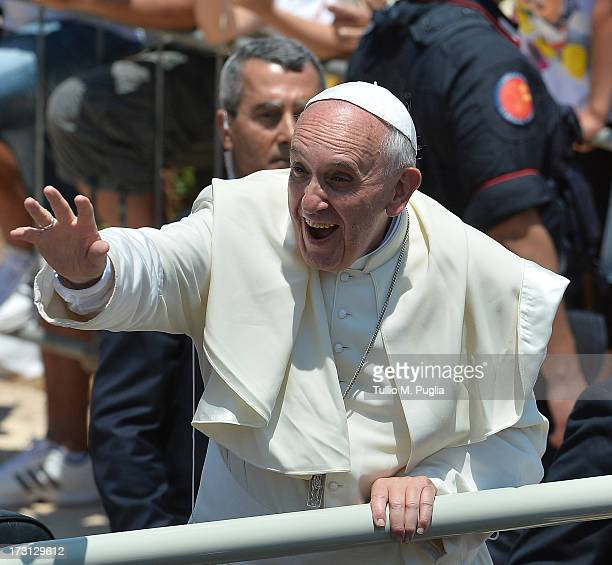 Pope Francis waves to the faithful after visiting San Gerlando churcv during his visit to the island on July 8 2013 in Lampedusa Italy On his first...