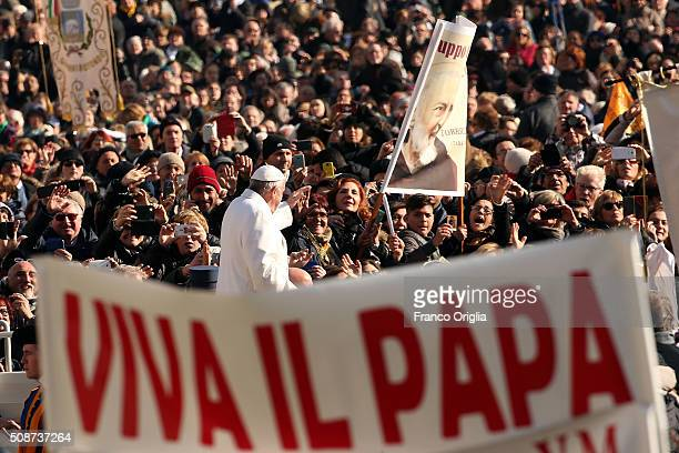 Pope Francis waves to the faithful as he arrives at St Peter's Square for a meeting with members of 'Padre Pio' Prayer Groups on February 6 2016 in...