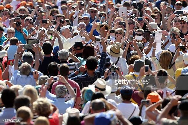 Pope Francis waves to the faithful as he arrives in St Peter's square for his weekly audience on June 3 2015 in Vatican City Vatican Speaking during...