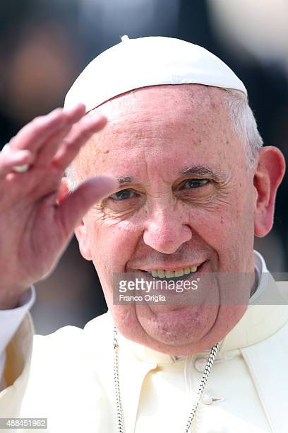 Pope Francis waves to the faithful as he arrives in St Peter's Square for his weekly audience on September 16 2015 in Vatican City Vatican Pope...