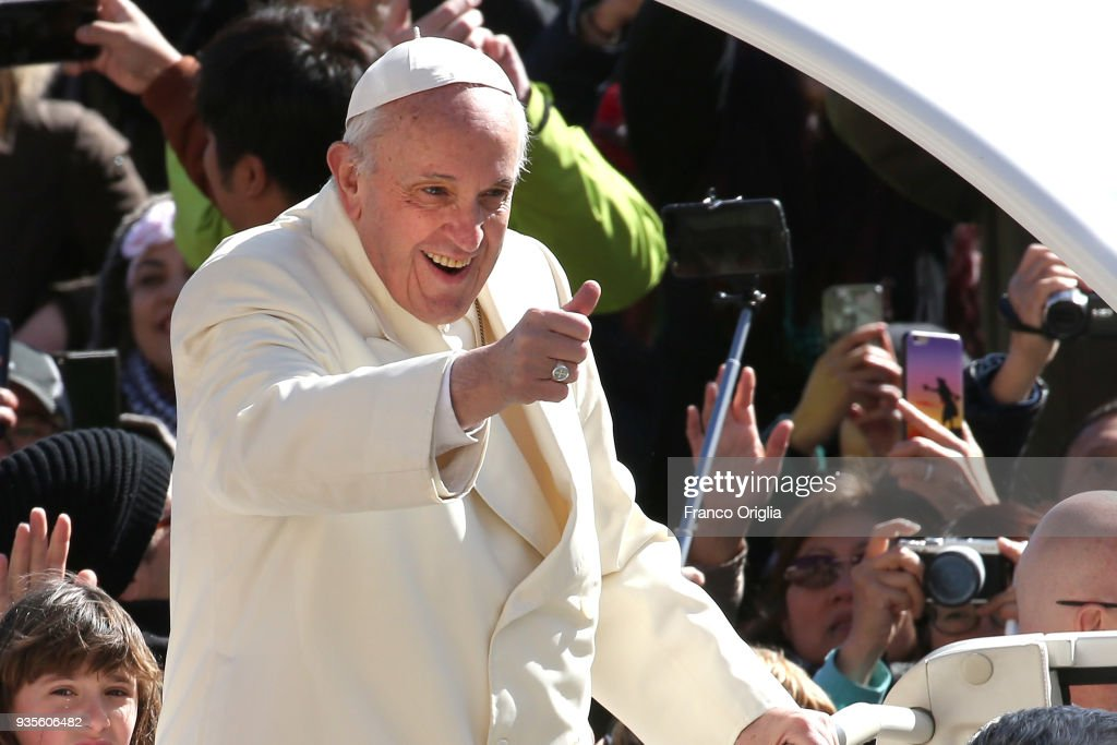 Pope Francis waves to the faithful as he arrives in St. Peter's Square for his weekly audience on March 21, 2018 in Vatican City, Vatican. Pope Francis will travel to Dublin, Ireland in August to attend the World Meeting of Families.