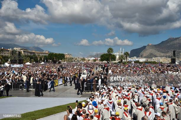 Pope Francis waves to the faithful as he arrives in the popemobile at the Foro Italico seafront lawn in Palermo, to give a mass in hommage to slain...