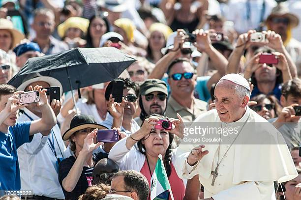 Pope Francis waves to the faithful as he arrives on popemobile to celebrate the mass for 'Evangelium Vitae' Day at at St Peter's Square on June 16...