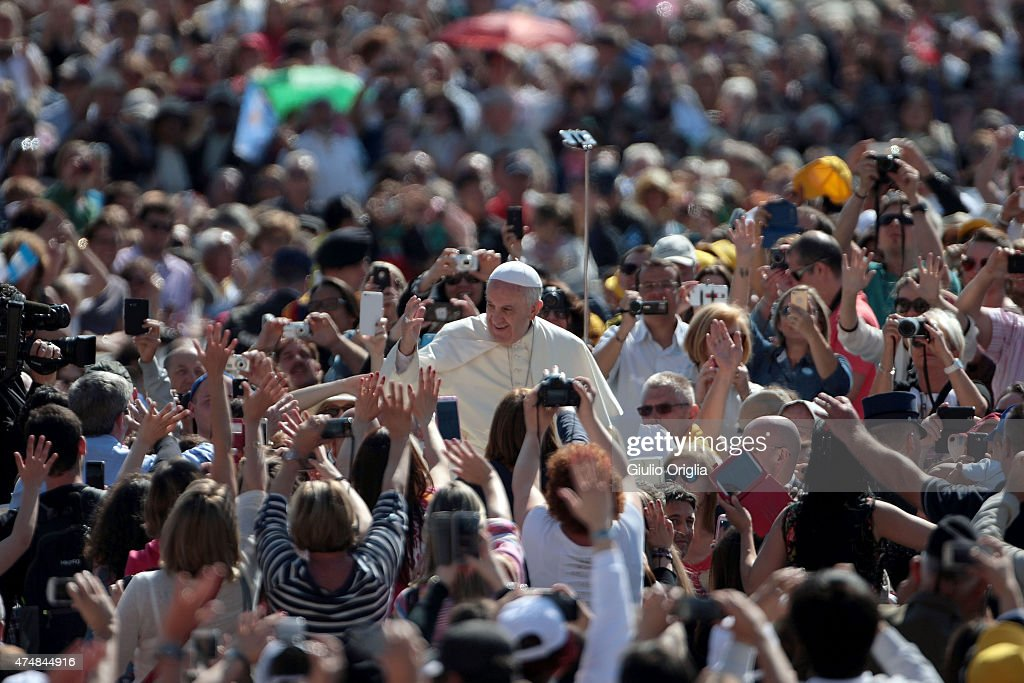 Pope Francis waves to the faithful as he holds his weekly audience in St. Peter's Square on May 27, 2015 in Vatican City, Vatican. During his speech the Pontiff spoke to couples who are engaged to be married and told them not to be superficial as they prepare to enter into a life-long covenant of love.