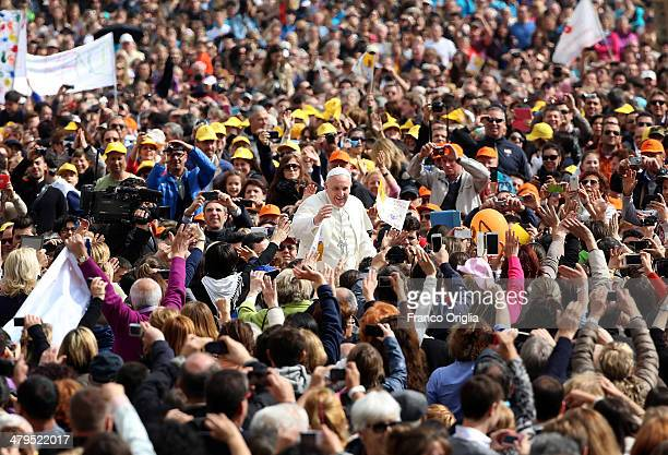 Pope Francis waves to the faithful as he holds his weekly audience in St Peter's Square on March 19 2014 in Vatican City Vatican Pope Francis...