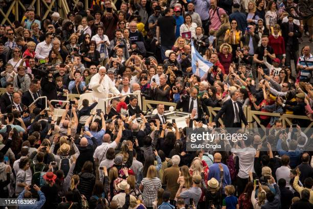 Pope Francis waves to the faithful as he leaves St Peter's Square at the end of the Easter mass on April 21 2019 in Vatican City Vatican Pope Francis...