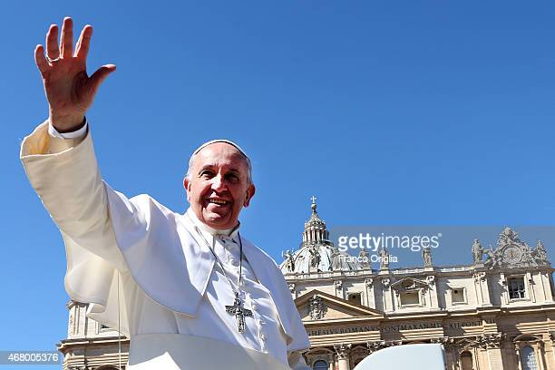 Pope Francis waves to the faithful as he leaves St Peter's Square at the the end of Palm Sunday Mass on March 29 2015 in Vatican City Vatican On Palm...