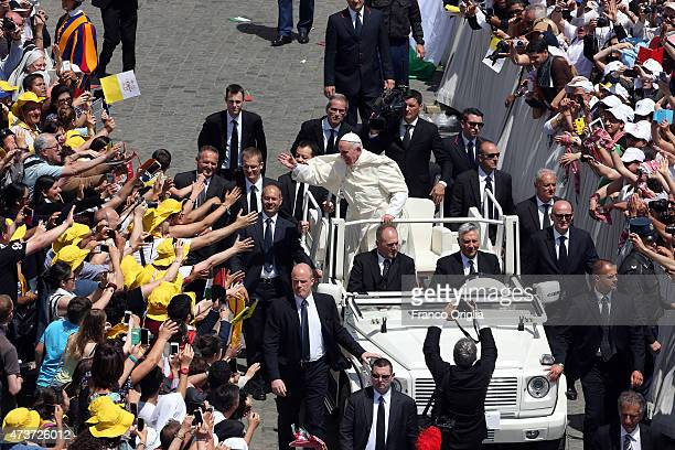 Pope Francis waves to the faithful as he leaves St Peter's Square at the end of a canonisation ceremony on May 17 2015 in Vatican City Vatican Pope...