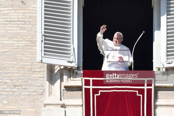 Pope Francis waves to the faithful during the weekly Angelus prayer on November 11 2018 at St Peter's square in the Vatican