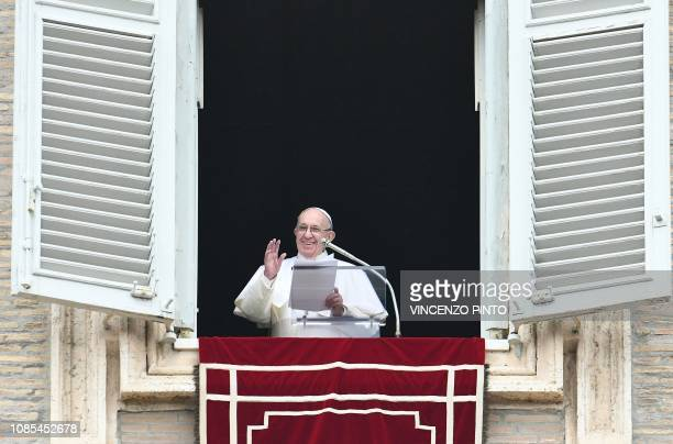 Pope Francis waves to the faithful from the window of the Apostolic Palace overlooking St Peter's square in the Vatican upon his arrival for the...