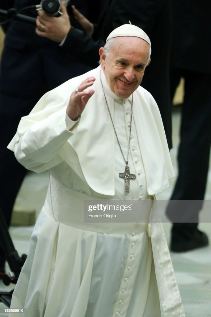 Pope Francis waves to the faithful gathered at the Paul VI Hall during his weekly audience on December 6, 2017 in Vatican City, Vatican. Pope Francis has appealed for respect for Jerusalem's status quo according to the pertinent United Nations Resolutions regarding the city.