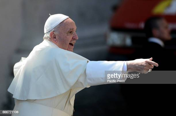 Pope Francis waves to the people who attended the Palm Sunday mass in place in St Peter's Square with dozens of faithful who carried with them the...