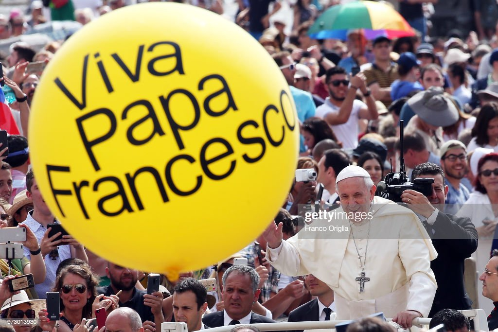 Pope Francis waves to the pilgrims gathered in St. Peter's Square for the general audience on June 13, 2018 in Vatican City, Vatican. Pope Francis looked ahead to a month of top class football during his General Audience expressing his hope the FIFA World Cup Russia will favour solidarity and peace among nations.