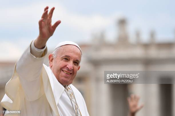 Pope Francis waves to worshipers at the end of the weekly general audience on April 3 2019 at St Peter's square in the Vatican