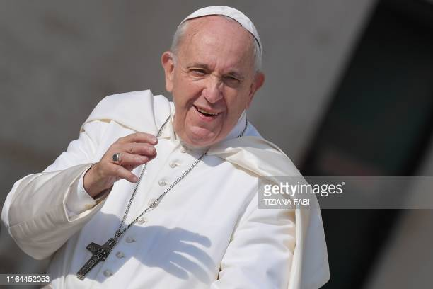Pope Francis waves to worshipers upon his arrival for the weekly general audience on August 28 2019 at St Peter's square in the Vatican