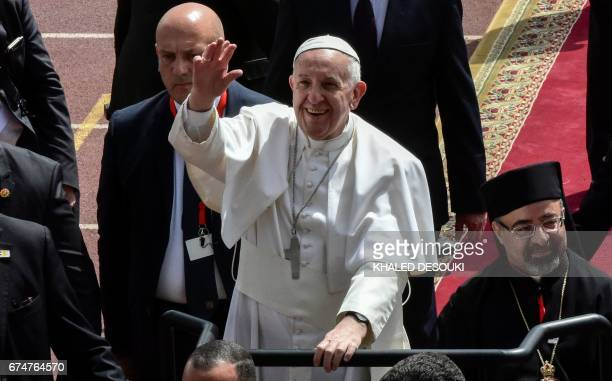 Pope Francis waves to worshippers from above an uncovered Popemobile before the start of a mass on April 29 2017 at a stadium in the Egyptian capital...
