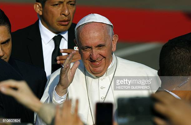 Pope Francis waves upon arrival at Francisco J Mujica airport in Morelia Michoacan State Mexico on February 16 2016 Pope Francis arrived in Mexico's...