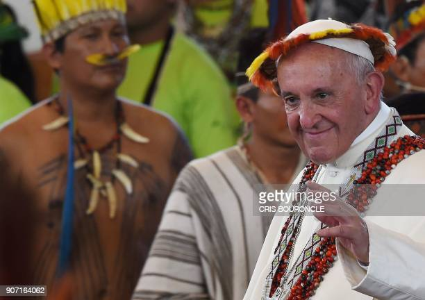 TOPSHOT Pope Francis wearing gifts leaves after a meeting with representatives of indigenous communities of the Amazon basin from Peru Brazil and...