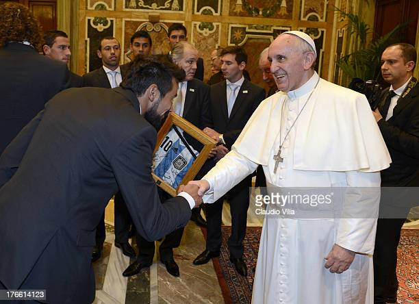 Pope Francis welcomes Ezequiel Lavezzi of Argentina during a private audience at The Vatican on August 13 2013 in Vatican City Vatican