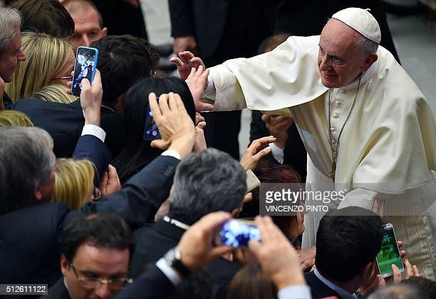 Pope Francis welcomes members of the Confindustria during an audience on February 27, 2016 in the Paul VI hall at the Vatican. / AFP / VINCENZO PINTO