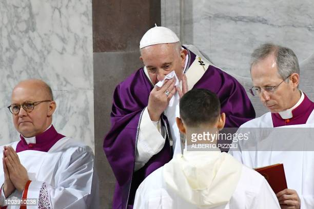 Pope Francis wipes his nose during the Ash Wednesday mass which opens Lent, the forty-day period of abstinence and deprivation for Christians before...