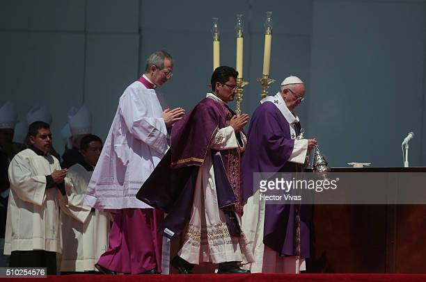Pope Francis wlaks with a censer during a mass for the people at El Caracol on February 14, 2016 in Ecatepec, Mexico. Pope Francis is on a five days...