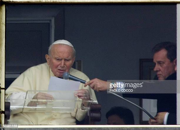 Pope John Paul II addresses pilgrims behind the window of Rome's Gemelli hospital 13 March 2005, during his traditional Sunday Angelus prayer. The...