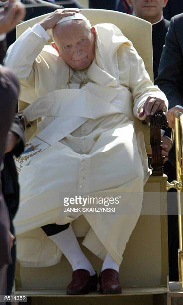 Pope John Paul II appears behind bishops and cardinals during a welcoming ceremony at Bratislava airport 11 September 2003 A frail Pope John Paul II...