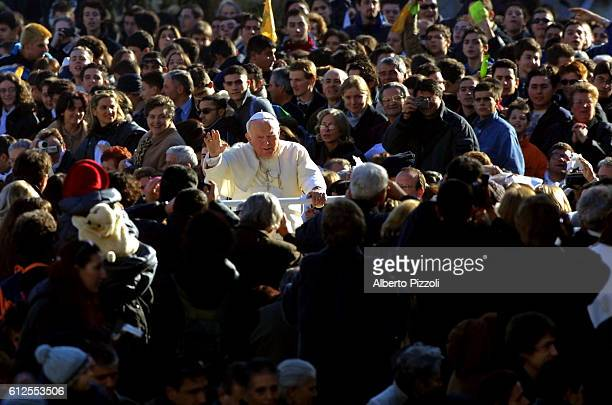 Pope John Paul II arriving in St Peter's Square for an open air audience.