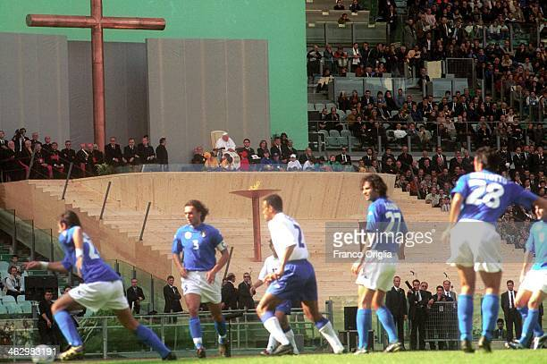 Pope John Paul II attends an exhibition soccer match between Italy National Team and foreigners who play in Italy as part of a special Sports Jubilee...
