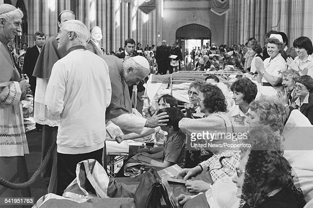 Pope John Paul II blesses members of the congregation at a service for the sick and disabled at St George's Cathedral Southwark in London during the...
